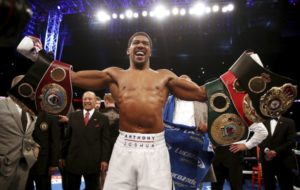 Anthony Joshua holding its belts