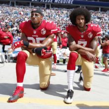 Kaepernick kneels during the National Anthem while playing for the San Francisco 49ers